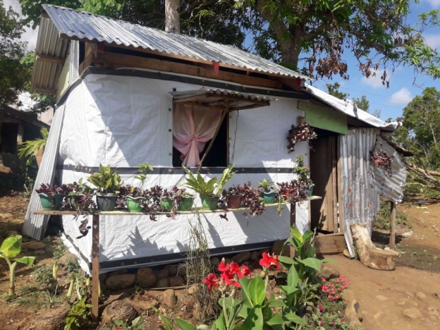 A shelter has been built in the Philippines using a ShelterKit with a garden in front