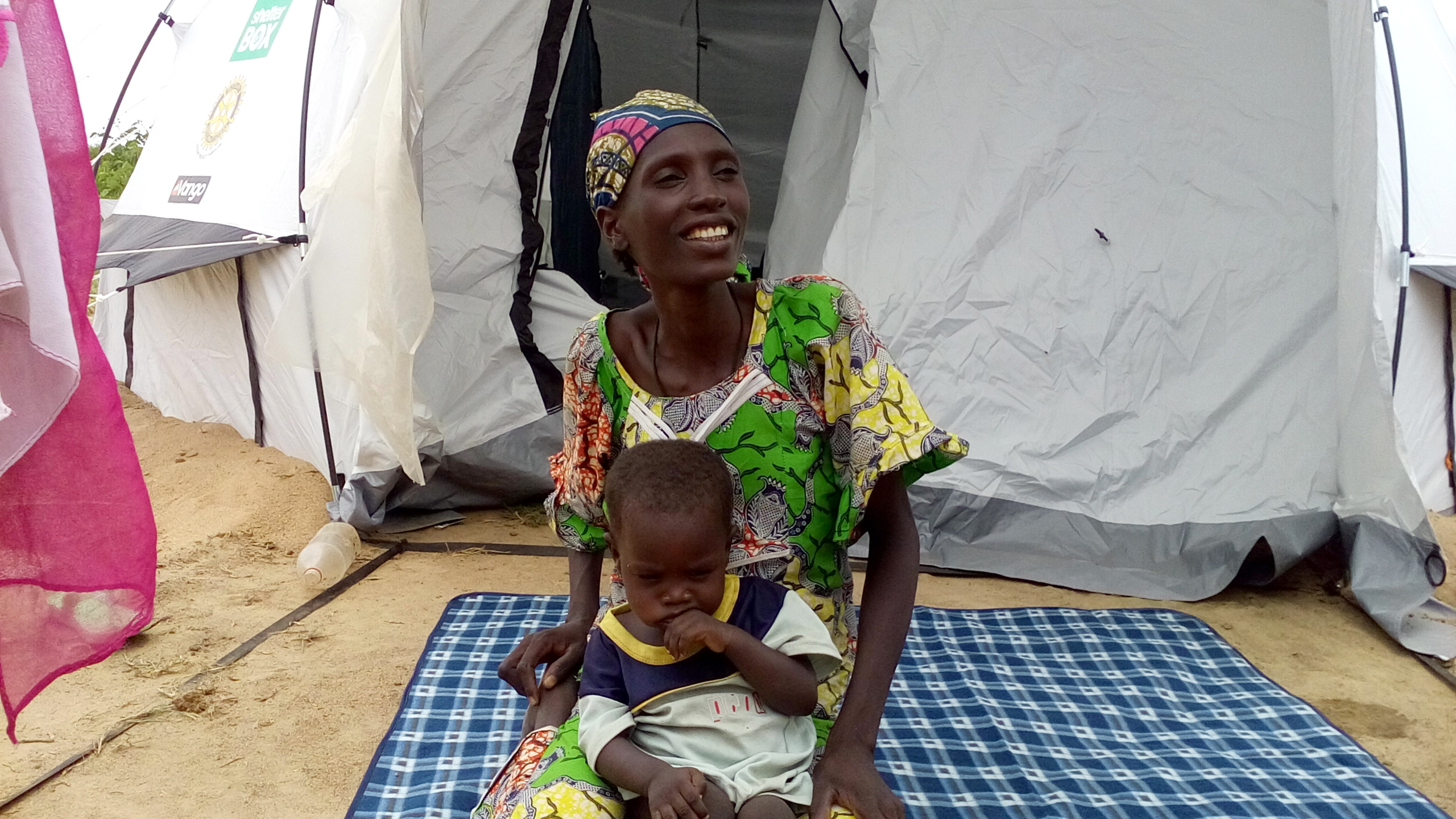 A mother and her child outside their shelter in Cameroon