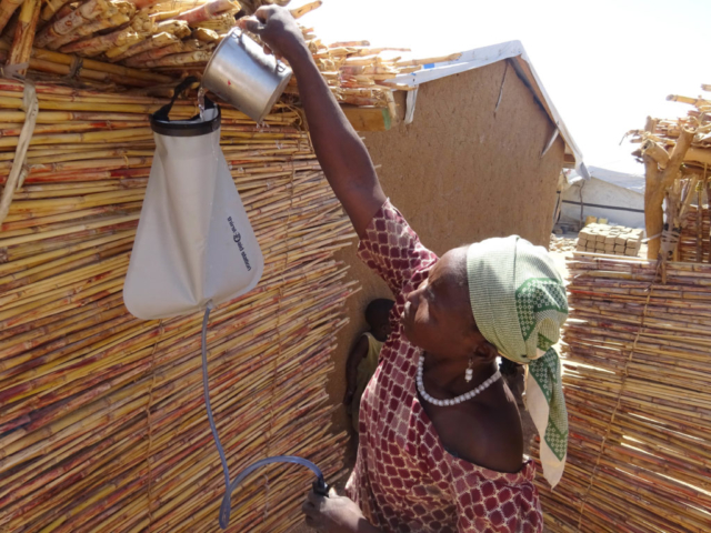 Maïramu from Cameroon fills her water filter