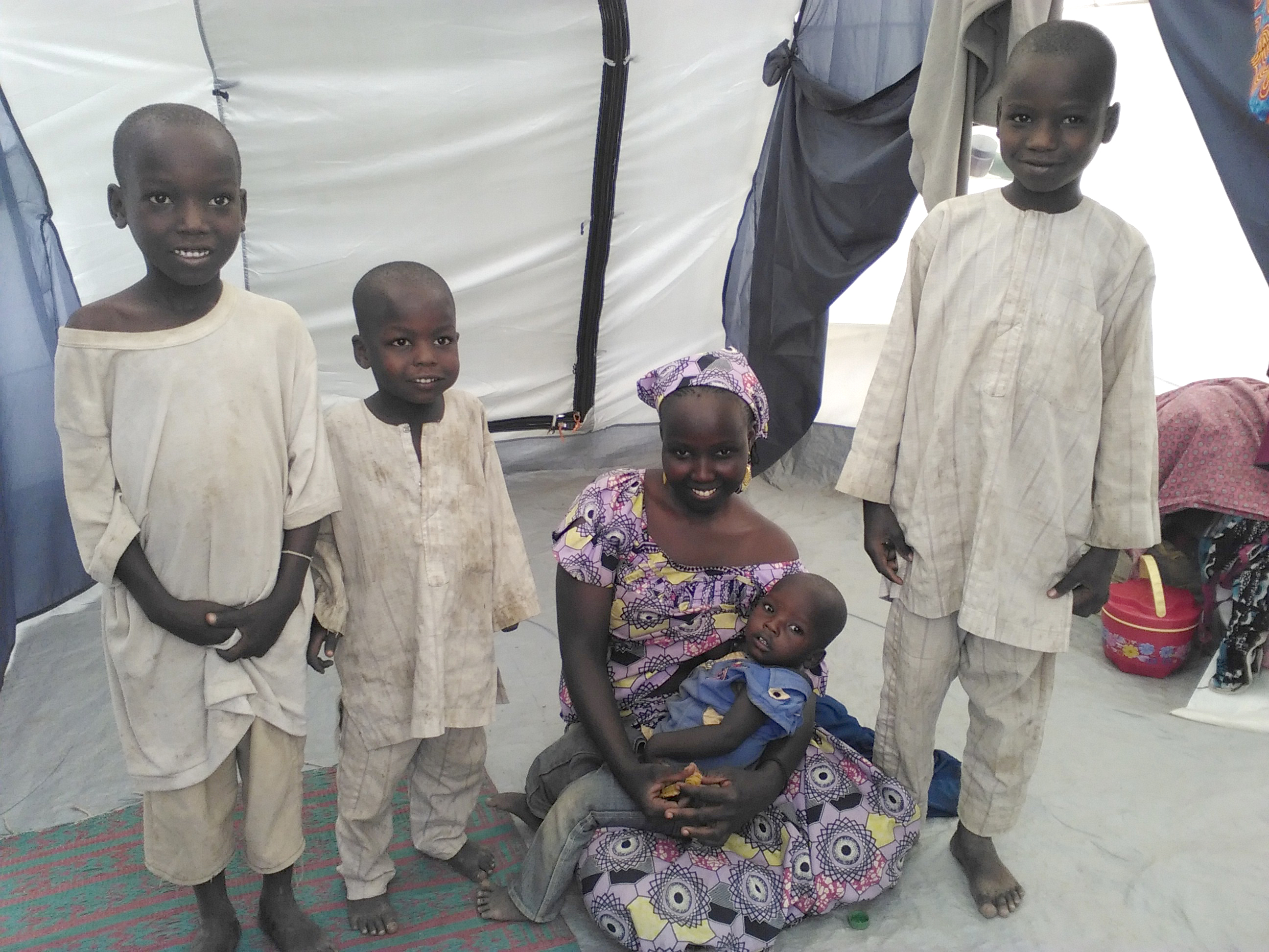 Mode takes care of her four children at a refugee camp in Cameroon
