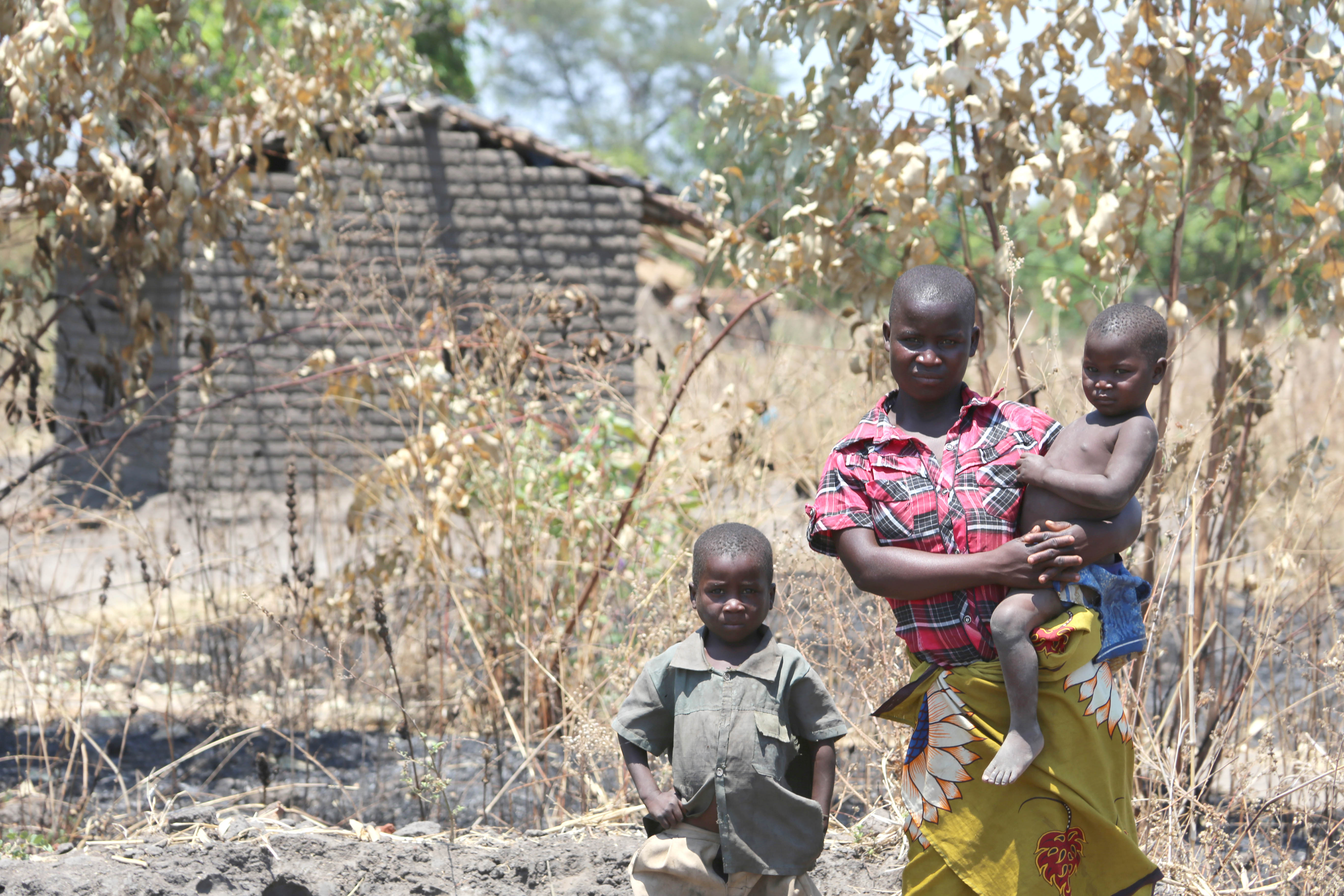 Alefa with her two children in Malawi