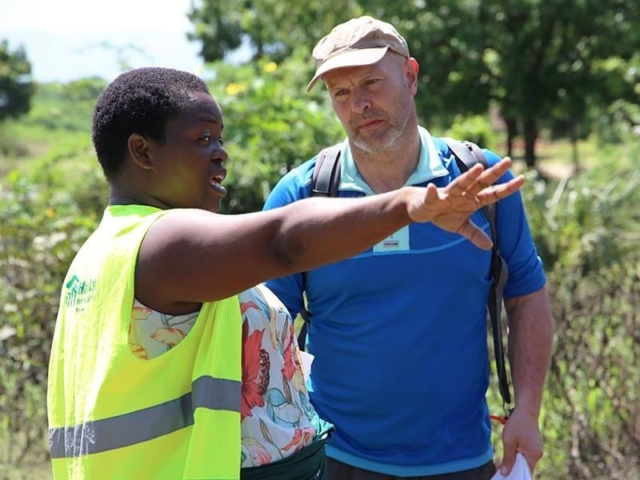Miriam in Malawi, speaking with a ShelterBox Response Team Member.