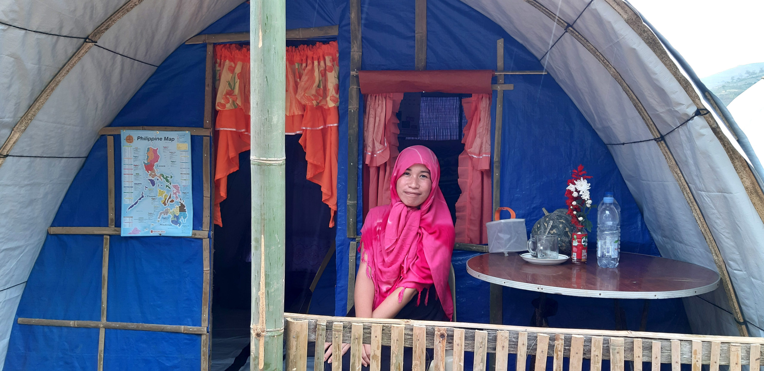 Woman sitting in front of her shelter