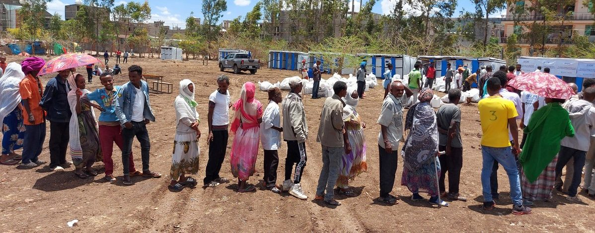 Families in Ethiopia line up to receive ShelterBox aid